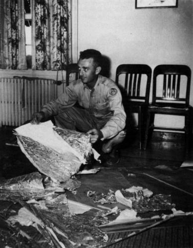 Jesse Marcel, pictured with the Roswell wreckage