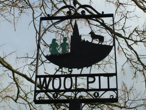 The Woolpit village sign, depicting the green children